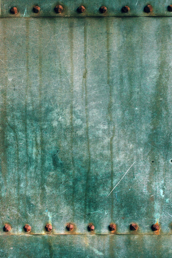 Oxidized copper plate surface texture. Abstract corroded metal background stock images