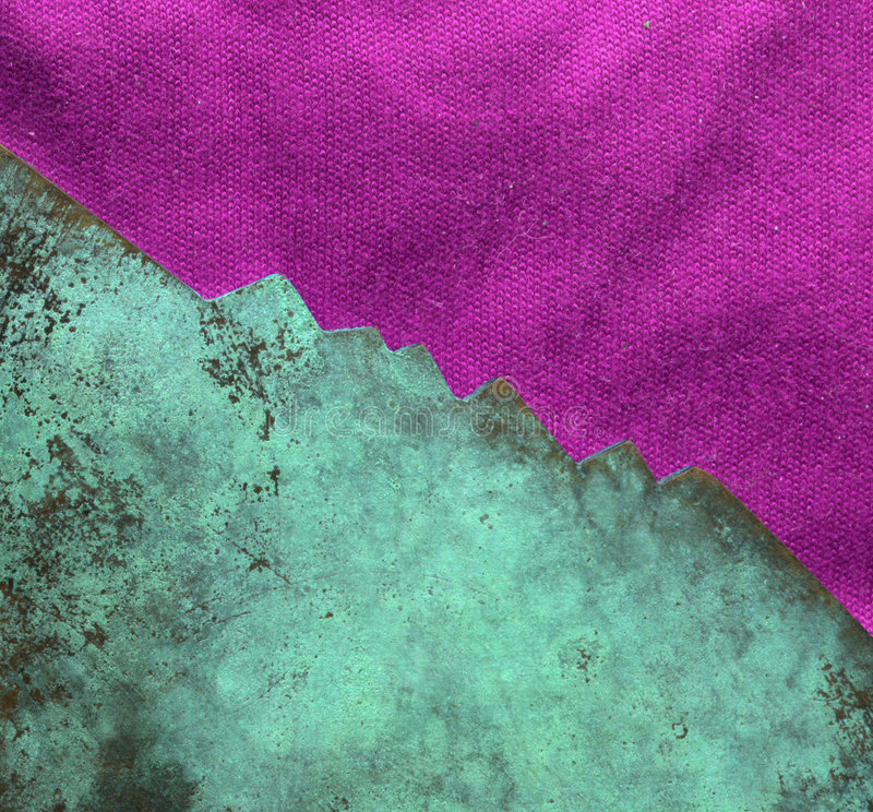 Oxidized copper texture. Showing green texture with pink cloth fabric royalty free stock image