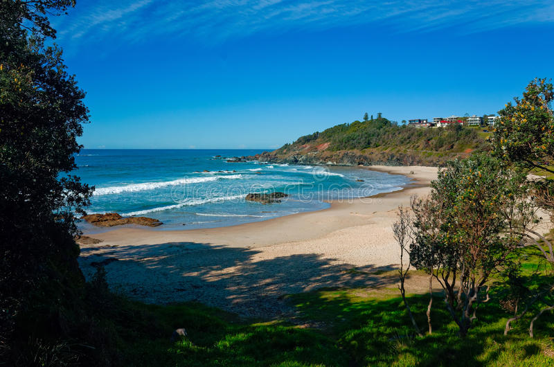 Oxley Beach at Port Macquarie Australia. With a park in the foreground. Beautiful Australian beach on the pacific ocean. View towards sea with surrounding grass stock photography