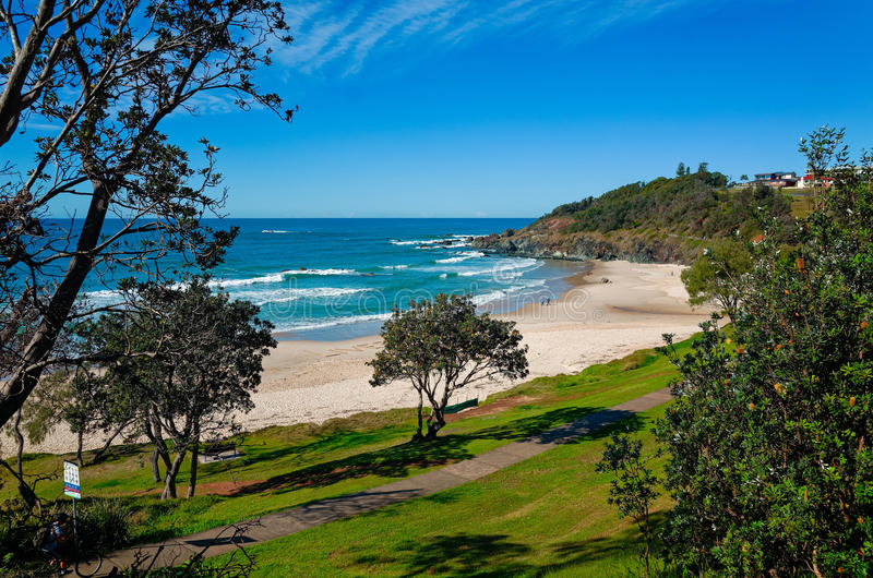 Oxley Beach at Port Macquarie Australia. With a park in the foreground. Beautiful Australian beach on the pacific ocean. View towards sea with surrounding grass stock photo