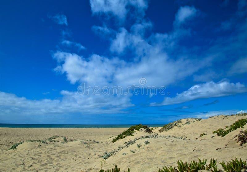 Oxnard California beach. Blue sky tan sand along the coastline of Mandalay Bay Beach in Oxnard California royalty free stock photography