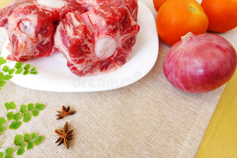 Oxtail raw & vegetables stock photography