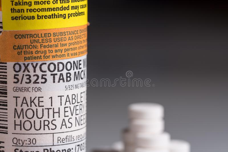Macro of oxycodone opioid tablet bottle royalty free stock photography