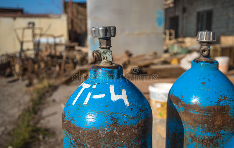 Oxygen and Gas Cylinders. High pressure oxygen or hydrogen storage tanks royalty free stock images