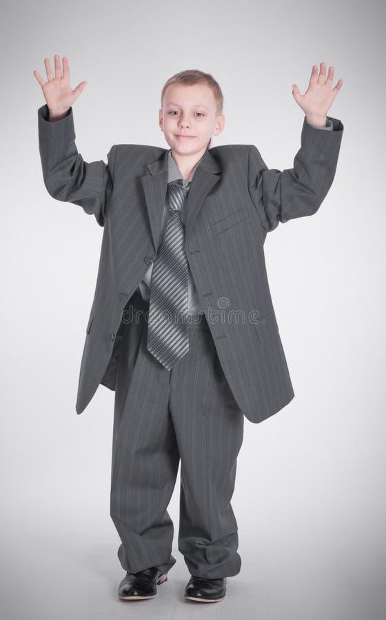 Oy stak zijn handen op stock fotografie