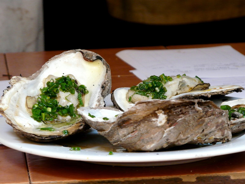 Oyster. BBQ Oyster in vietnamese style(taken in Hanoi royalty free stock photography