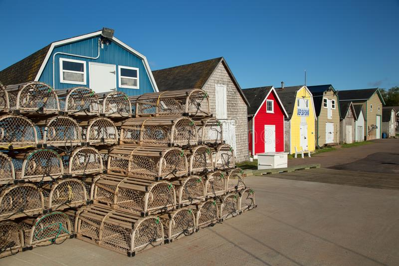 Oyster barns in Prince Edward island. Lobster cages in front of oysters barns in New London, Prince Edward island also called PEI royalty free stock photography