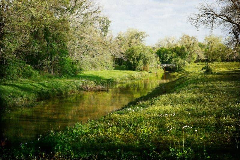 Oyster Creek Flowing Under Bridge royalty free stock image