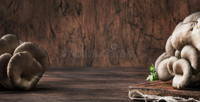 Oyster mushroom on vintage wooden kitchen table, still life in rustic style, selective focus stock photos