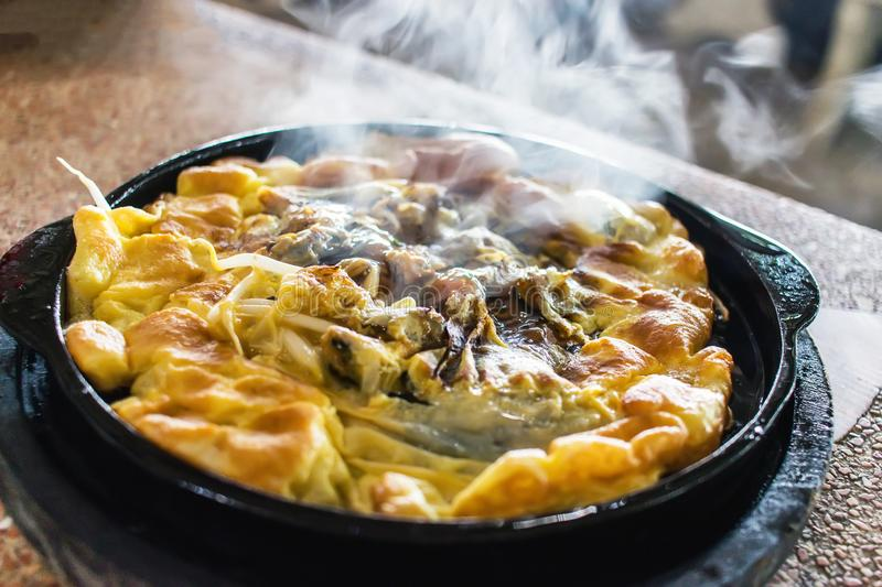 Oyster omelette in Hot pan. royalty free stock photo