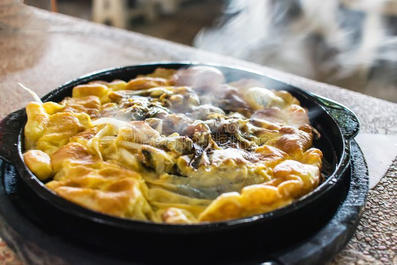 Oyster omelette in Hot pan. royalty free stock image
