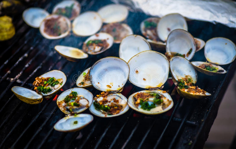 Oysters on the grill stock photography