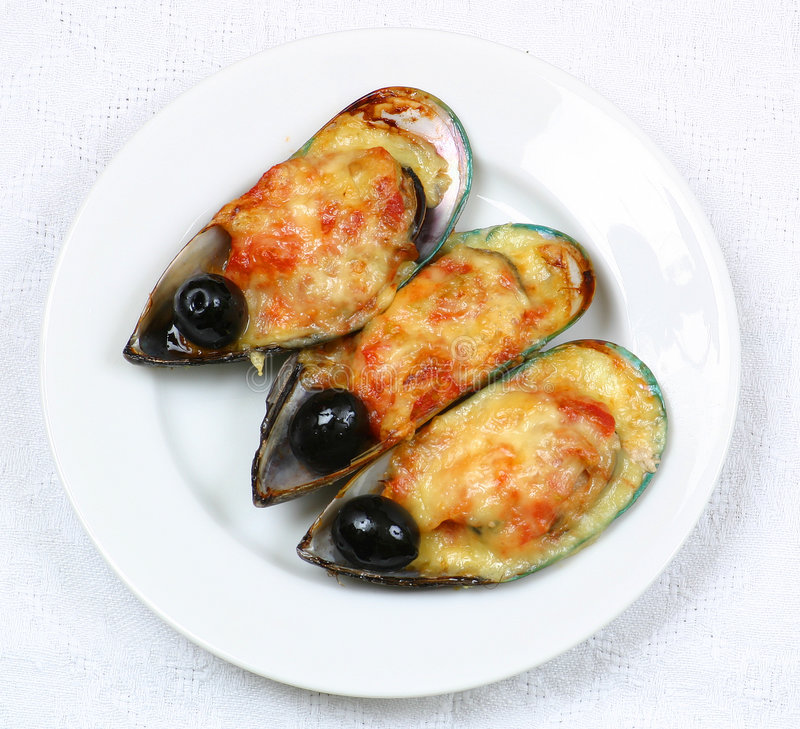 Oysters with olives royalty free stock images