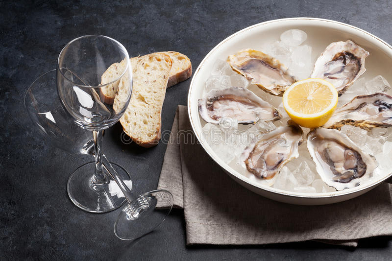 Oysters and wine royalty free stock photos