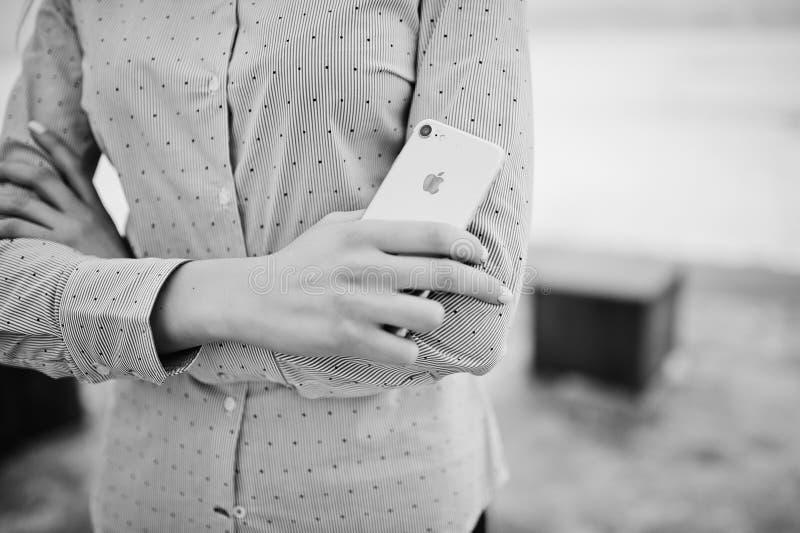 Ozerna, Ukraine - February 8, 2017: Close up Apple Iphone 7 on h. Ands at stylish girl. Black and white royalty free stock image