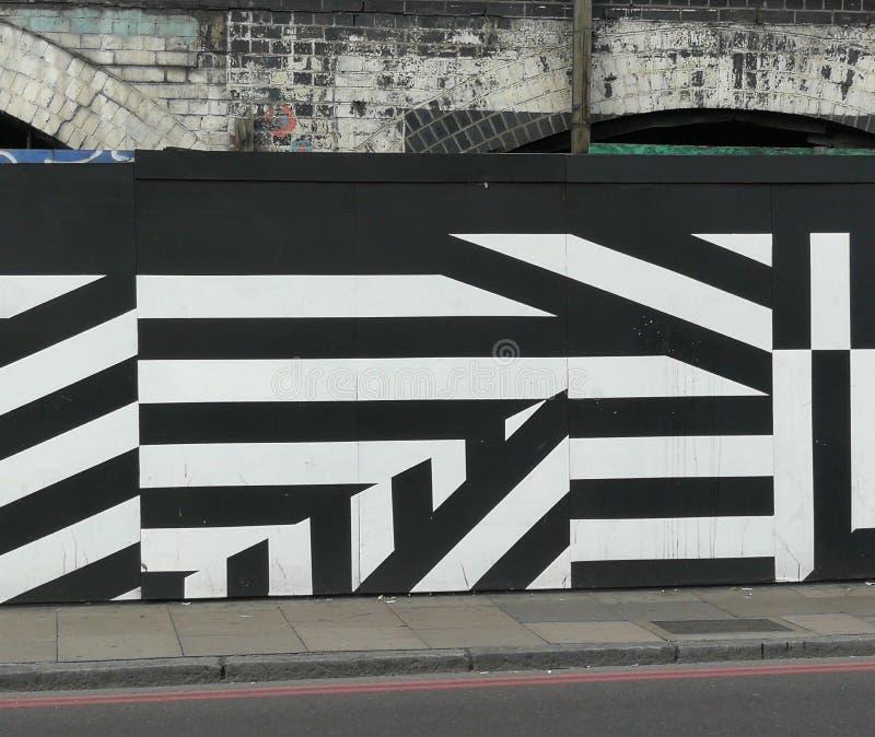 Geometric Street art / graffiti in London, Black and white stripes stock images