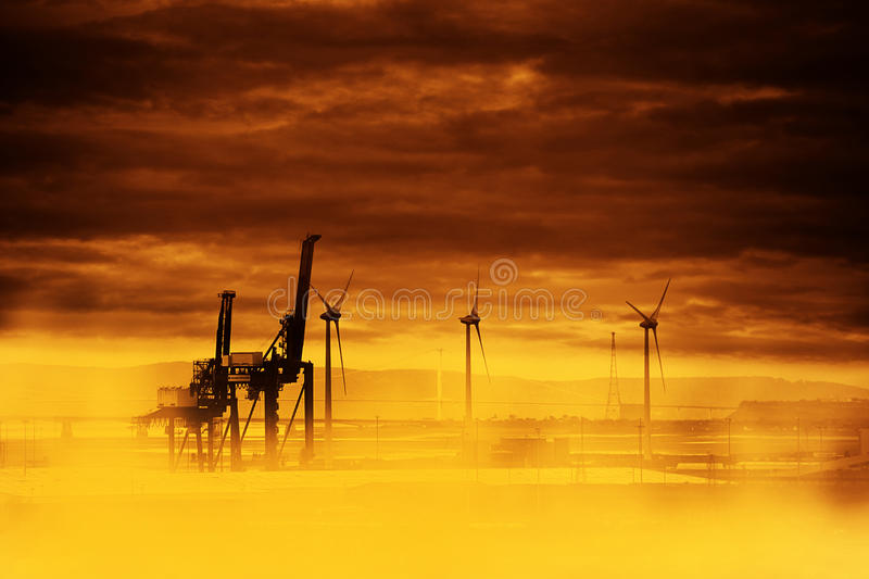 Ozone hole - big heat. Metal giraffe and windmills instead of trees - future of our earth with ozone hole royalty free stock image