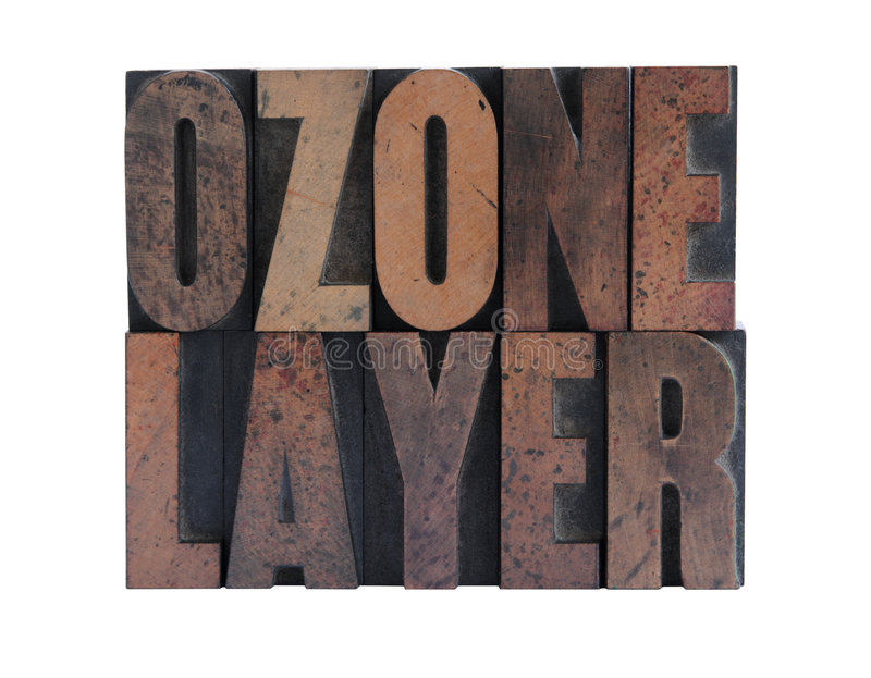 Ozone layer in letterpress wood type. The phrase 'ozone layer' in ink-stained wood letters isolated on white royalty free stock photos