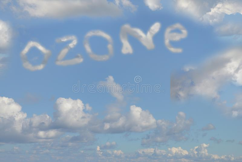 Ozone written in the sky with clouds. Pollution concept with the word ozone written in the sky with clouds royalty free stock photo