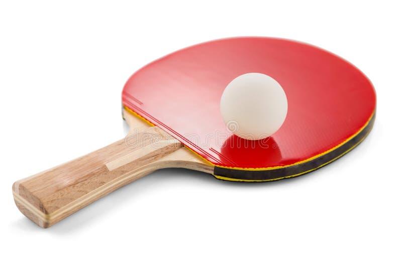 Pá e bola do pong do sibilo isoladas no fundo branco com sombras Foco seletivo fotografia de stock royalty free