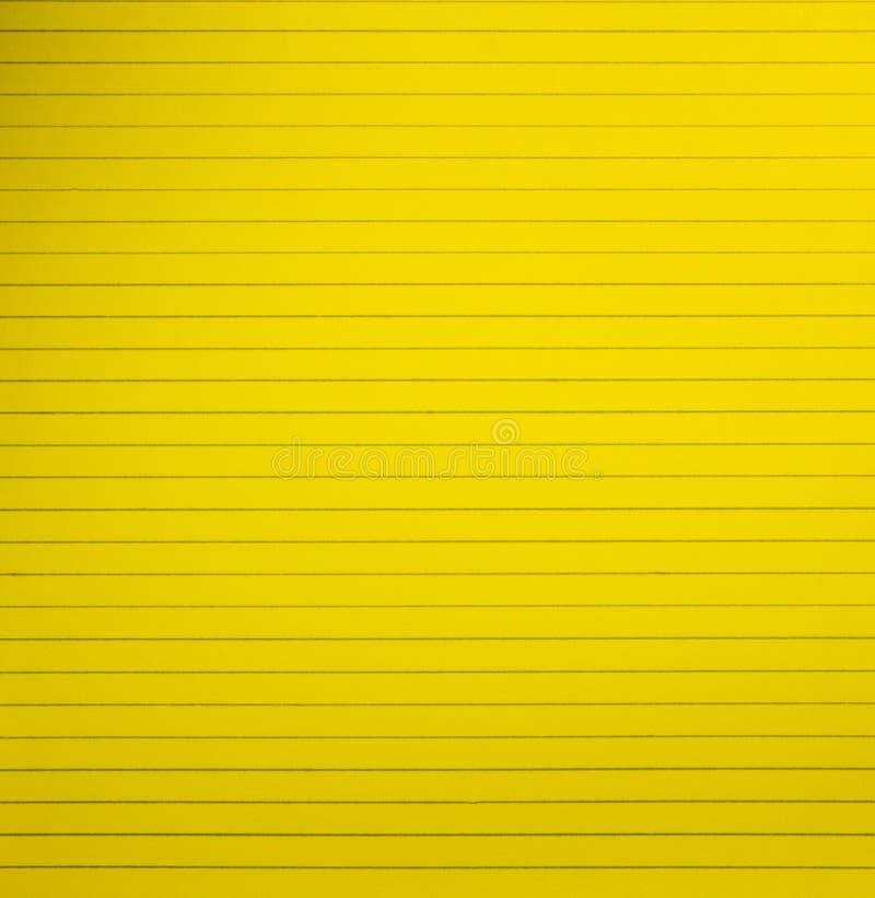 Página alineada espacio en blanco amarillo del papel del cuaderno fotografía de archivo