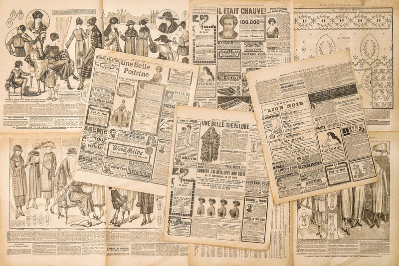 Páginas del periódico con la publicidad antigua imágenes de archivo libres de regalías