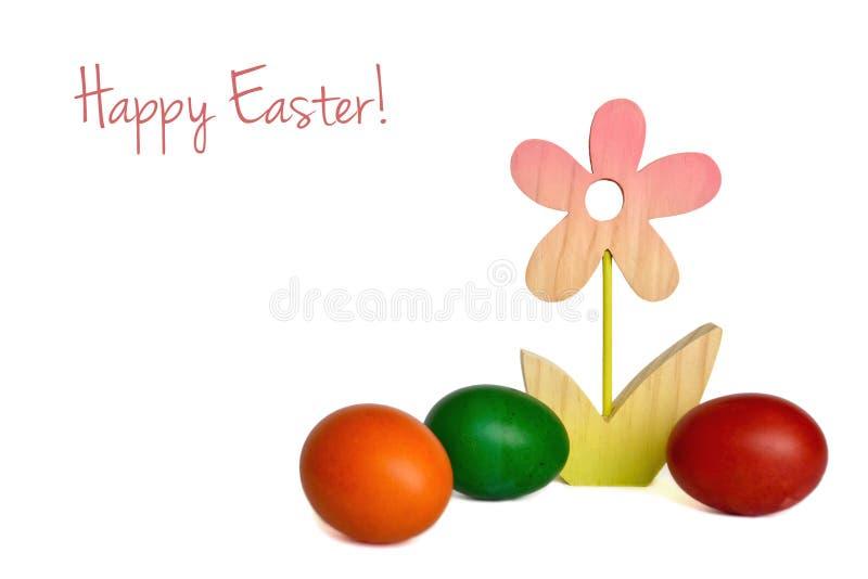 Páscoa feliz: Flor e ovos da páscoa de madeira imagens de stock