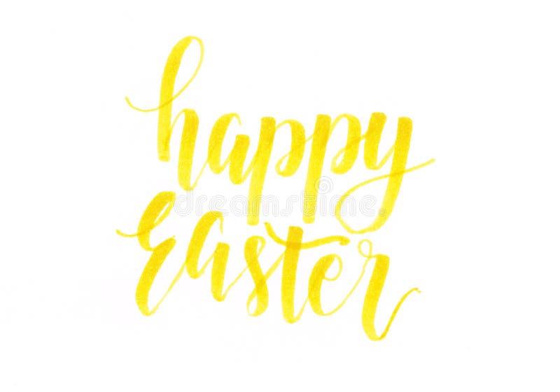 Páscoa feliz - inscrição amarela da rotulação da mão ilustração stock