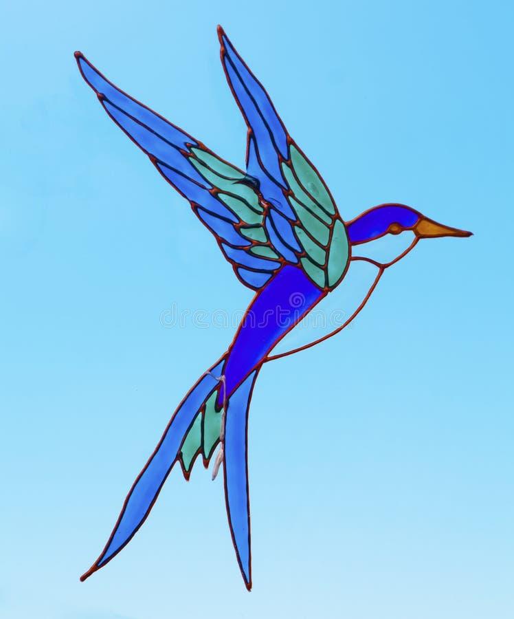 Pássaro do vidro manchado fotografia de stock royalty free