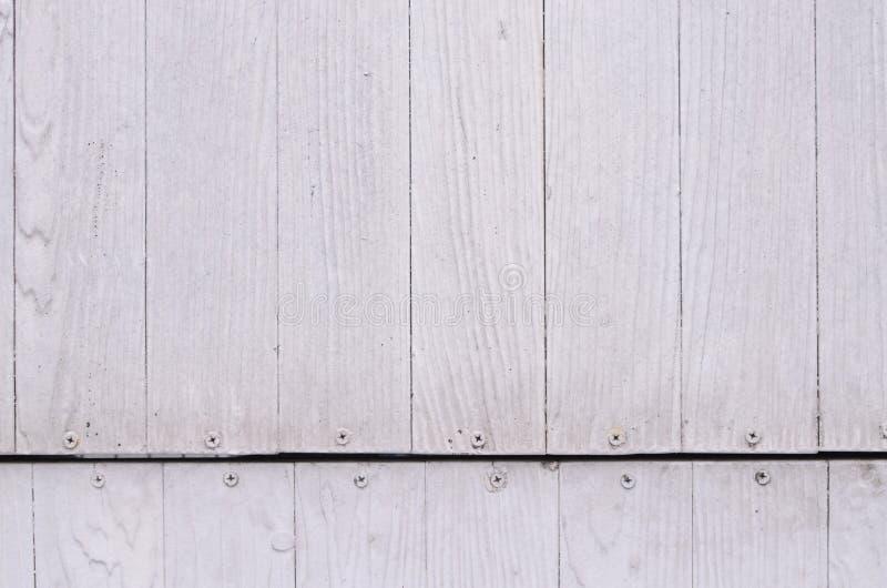 Pâlissez le modèle ou la texture et la tête en bois blanc de clou photos stock