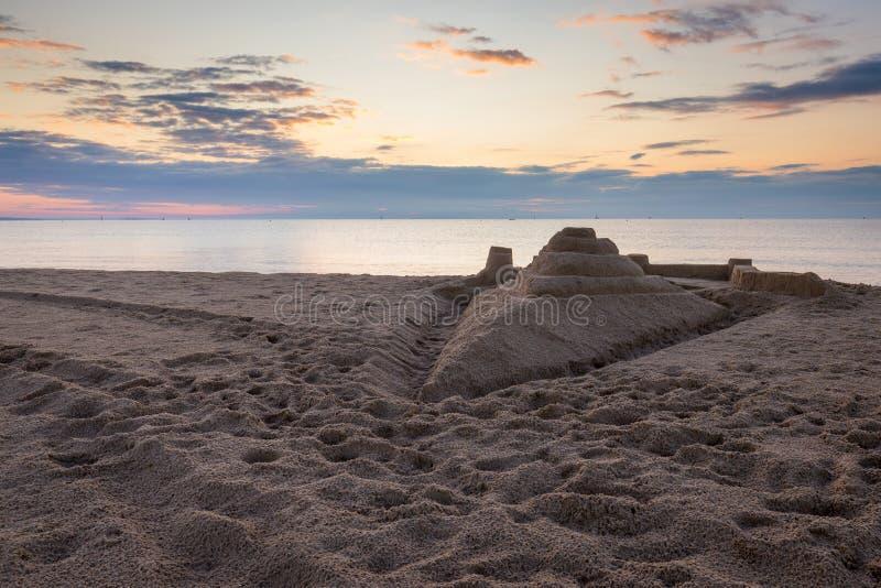 Pâté de sable de vaisseau spatial au lever de soleil photographie stock