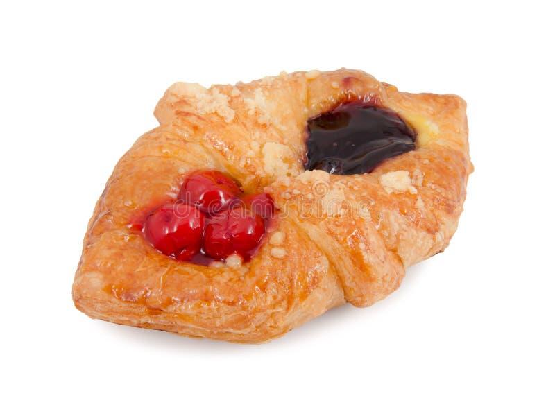 Pâtisserie danoise avec des fruits sur le fond blanc image libre de droits