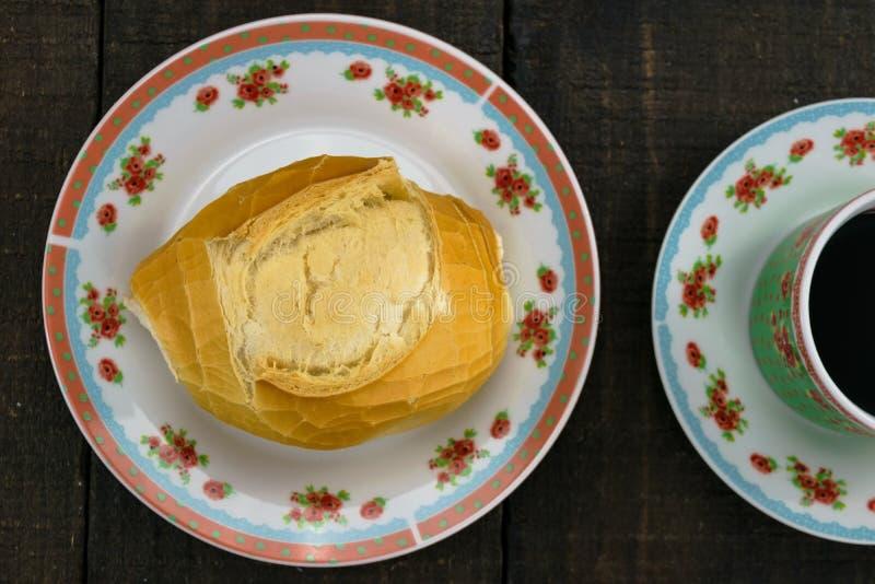 Pão frances acompanhado de café fotos de stock