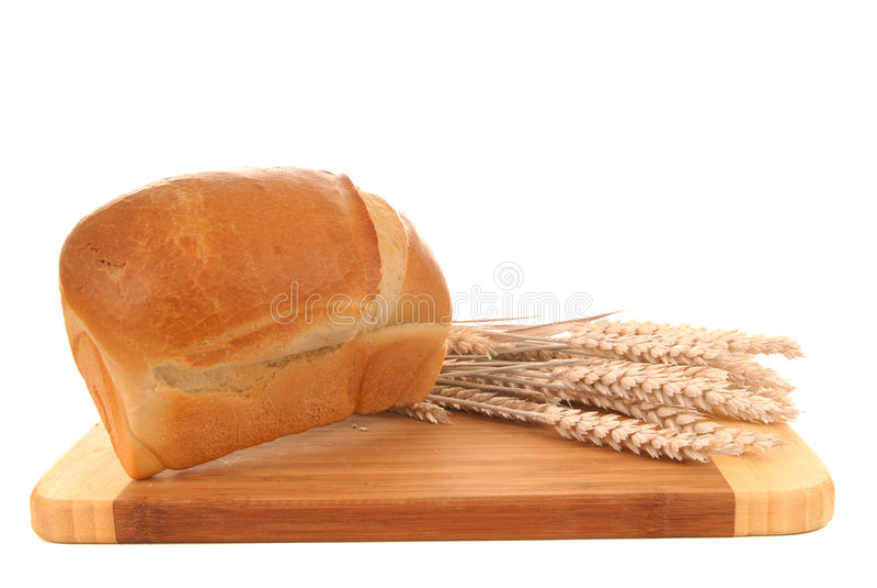 Pão branco na placa de estaca foto de stock royalty free