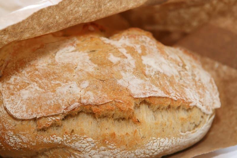 Pão de Ciabatta no saco marrom imagem de stock