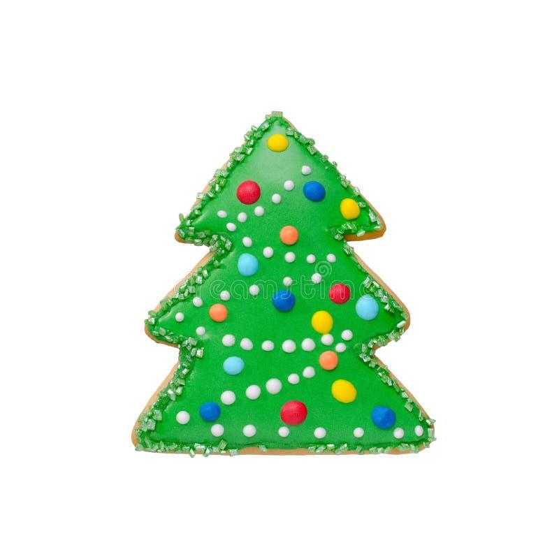 Pão-de-espécie da árvore de Natal, cookie do inverno decorada, isolado no branco imagem de stock