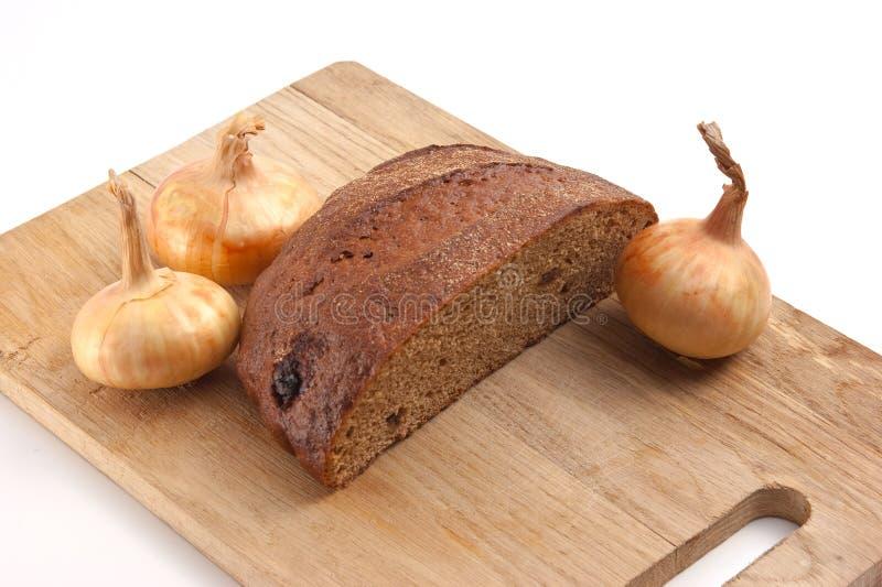 Pão e cebolas de Rye fotografia de stock