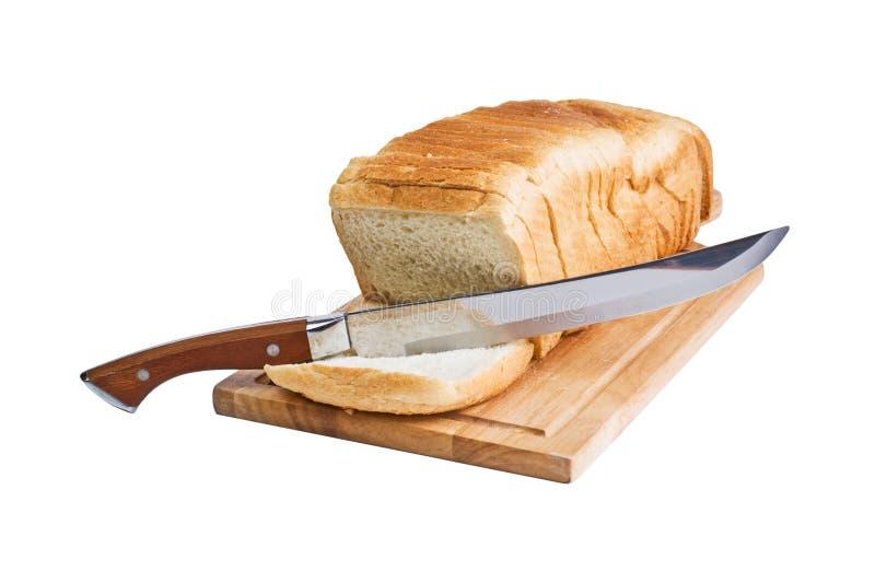 Pão e faca cortados imagem de stock