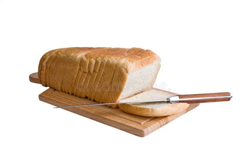 Pão e faca cortados fotos de stock royalty free