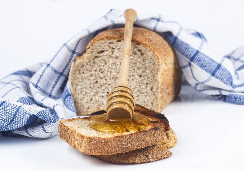 Pão e mel imagem de stock royalty free