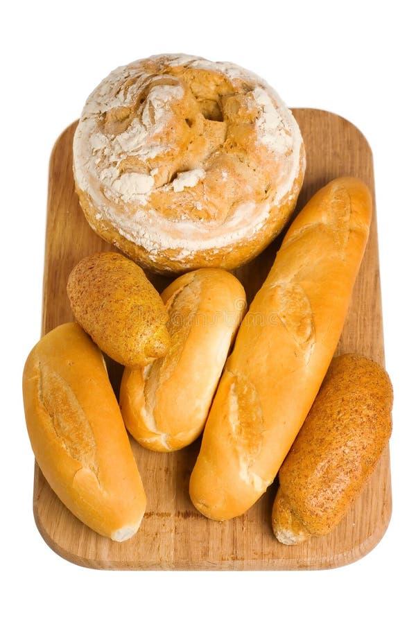 Pão e rolos no branco fotos de stock royalty free