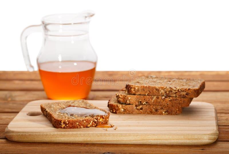 Pão fresco e mel fotografia de stock