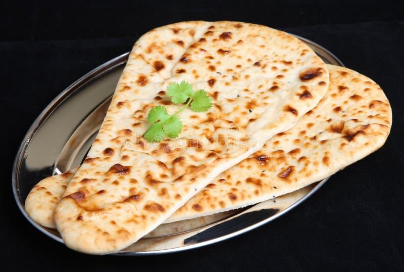 Pão indiano de Naan do alimento isolado imagens de stock royalty free