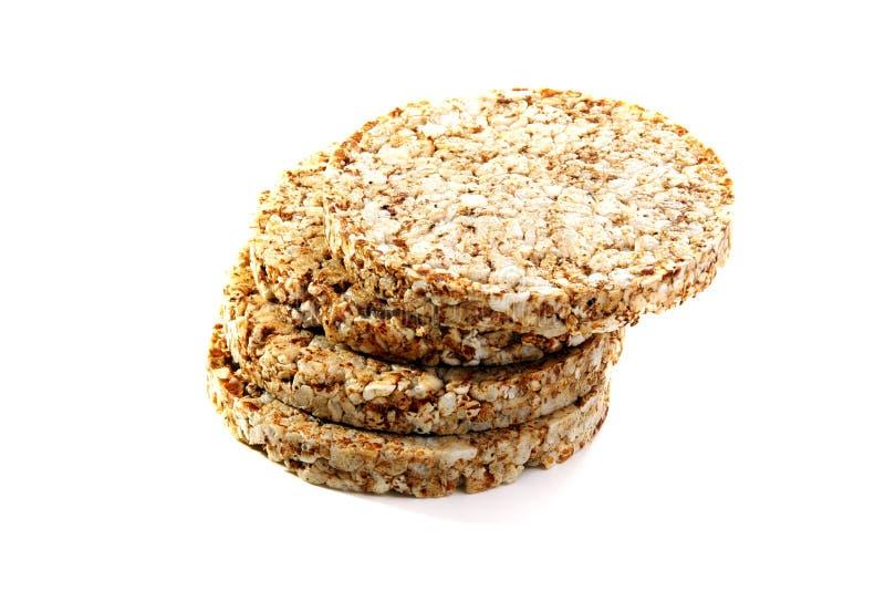 Pão inteiro do trigo mourisco da grão em um fundo branco. foto de stock