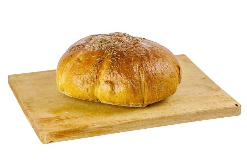 Pão na placa de madeira isolada no branco fotografia de stock royalty free