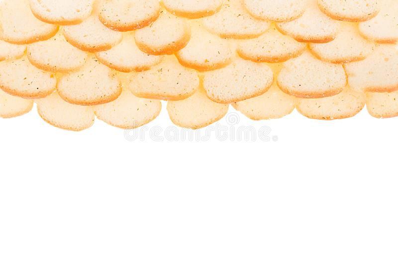 Pão torrado pequeno branco do naco corado como a beira isolada no fundo branco, vista superior Fundo do fast food imagem de stock royalty free