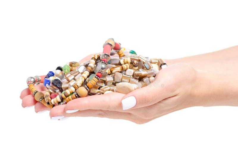 Pärlor stenar många färgrika olika i handskönhet arkivbilder