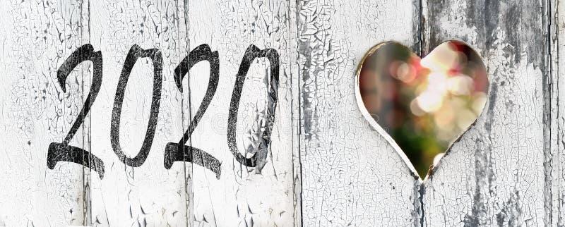 2020 på en vit målad dörr royaltyfri bild