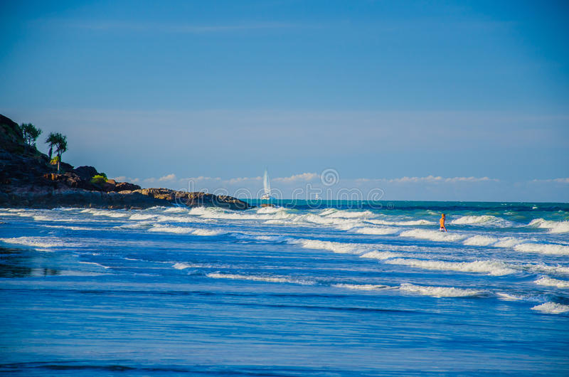 På stranden av Port Douglas royaltyfri bild