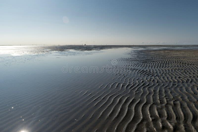 På stranden av St Peter-Ording arkivfoto